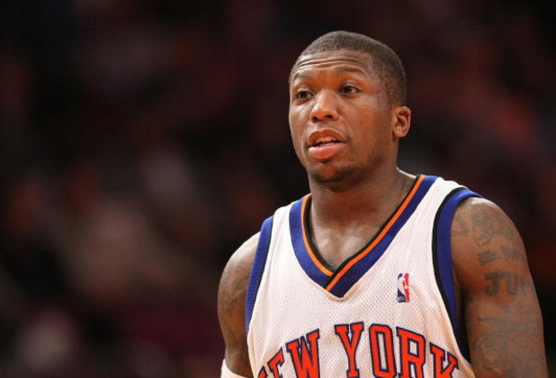 NEW YORK - MARCH 07:  Nate Robinson #4 of the New York Knicks looks on against the Charlotte Bobcats on March 7, 2009 at Madison Square Garden in New York City. NOTE TO USER: User expressly acknowledges and agrees that, by downloading and or using this ph
