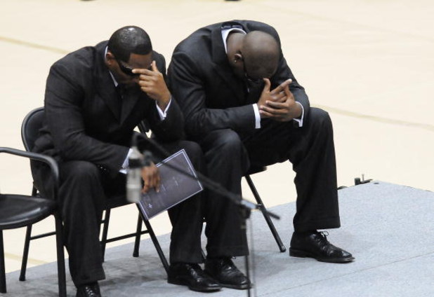 HATTIESBURG, MS - JULY 11:  Baltimore Ravens player Ray Lewis, left, and Tennessee Titans quarterback Vince Young react during funeral services for former NFL quarterback Steve McNair on July 11, 2009 in Hattiesburg, Mississippi.  (Photo by George Clark -