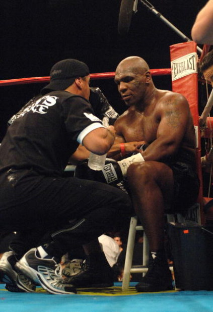 WASHINGTON - JUNE 11:  Mike Tyson receives instructions in his corner during his heavyweight bout against Kevin McBride at the MCI Center June 11, 2005 in Washington, DC.  (Photo by Mitchell Layton/Getty Images)