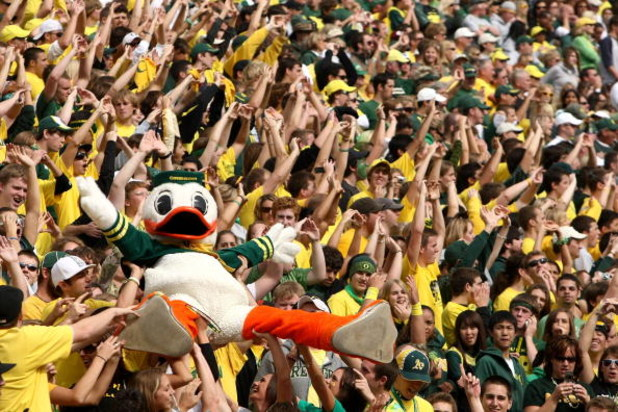 EUGENE, OR - OCTOBER 13:   The Oregon Duck mascot is carried by the crowd against the Washington State Cougars at Autzen Stadium October 13, 2007 in Eugene, Oregon.  (Photo by Jonathan Ferrey/Getty Images)