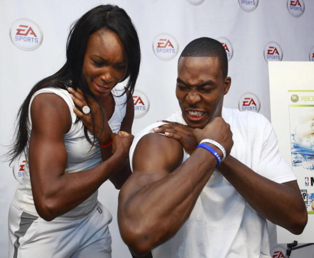 BURNABY, CANADA - JULY 13: In this photo provided by EA Sports, Dwight Howard of the NBA's Orlando Magic and tennis star Venus Williams compare their biceps during the EA Sports King of the Court competition July 13,2009 in Burnaby, Canada.  Dwight Howard