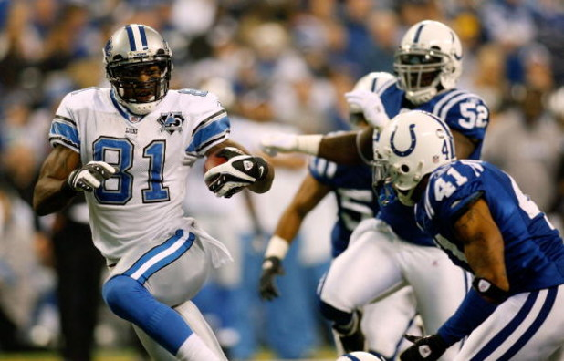 INDIANAPOLIS - DECEMBER 14:  Calvin Johnson #81 of the Detroit Lions gets past Antoine Bethea #41 of the Indianapolis Colts to score a touchdown on December 14, 2008 at Lucas Oil Stadium in Indianapolis, Indiana.  (Photo by Chris Graythen/Getty Images)