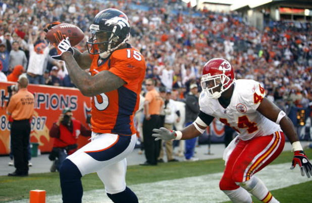 DENVER - DECEMBER 7:  Wide receiver Brandon Marshall #15 of the Denver Broncos catches a touchdown pass in front of Jarrad Page #44 of the Kansas City Chiefs during the second quarter of week 14 NFL action at Invesco Field at Mile High on December 7, 2008