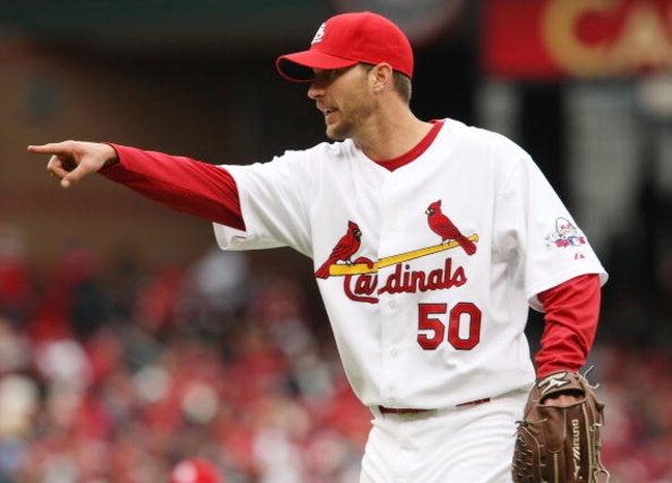 ST. LOUIS - APRIL 06:  Adam Wainwright #50 of the St. Louis Cardinals points to the umpire against the Pittsburgh Pirates during Opening Day on April 6, 2009  at Busch Stadium in St. Louis, Missouri. The Pittsburgh Pirates defeated the St. Louis Cardinals