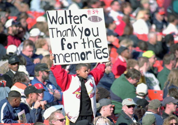 6 Nov 1999:  A young fan holds up a sign during Walter Payton's Memorial Service at Soldier Field in Chicago, Illinois. Mandatory Credit: Jonathan Daniel  /Allsport