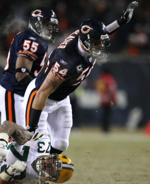 CHICAGO - DECEMBER 22: Brian Urlacher #54 of the Chicago Bears sheds a block by Daryn Colledge #73 of the Green Bay Packers on December 22, 2008 at Soldier Field in Chicago, Illinois. (Photo by Jonathan Daniel/Getty Images)