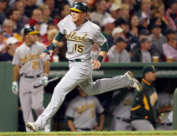 BOSTON - JULY 07:  Ryan Sweeney #15 of the Oakland Athletics scores a run in the fifth inning against the Boston Red Sox on July 7, 2009 at Fenway Park in Boston, Massachusetts.  (Photo by Elsa/Getty Images)