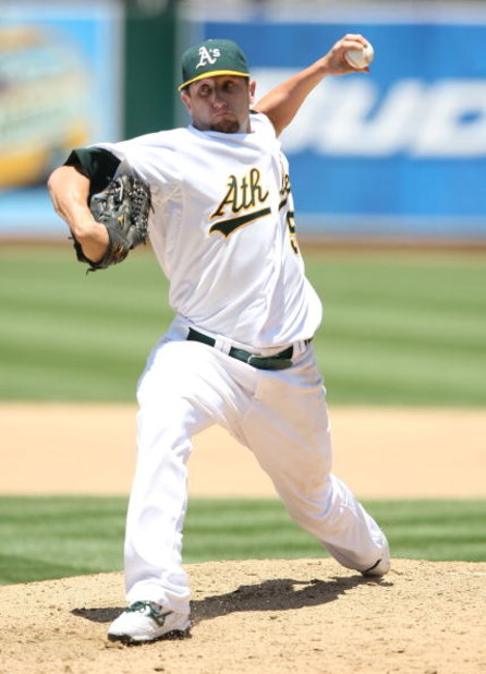 OAKLAND, CA - JULY 01: Dallas Braden #51 of the Oakland Athletics pitches against the Detroit Tigers during a Major League Baseball game on July 1, 2009 at the Oakland Coliseum in Oakland, California.  (Photo by Jed Jacobsohn/Getty Images)