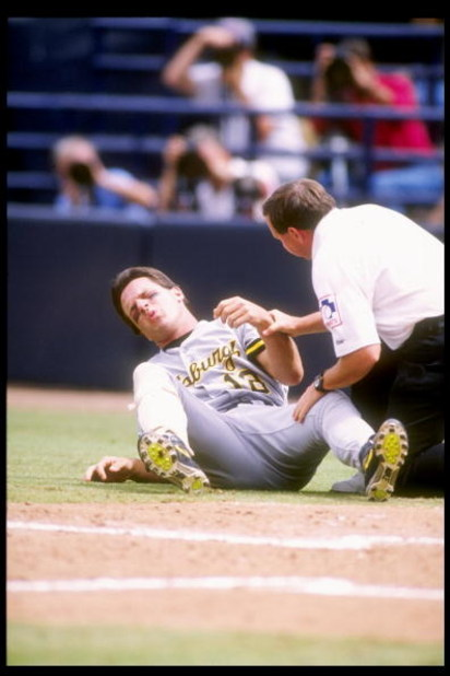 27 May 1992:  Andy Van Slyke of the Pittsburgh Pirates lays on the ground after being hit with a pitch during a game against the San Diego Padres at Jack Murphy Stadium in San Diego, California. Mandatory Credit: Stephen Dunn  /Allsport