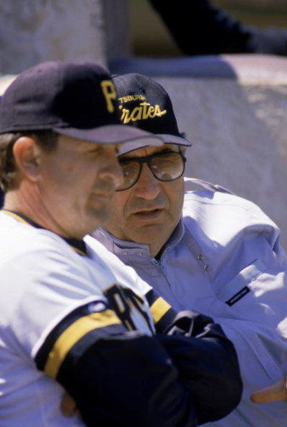 1988:  General manager Syd Thrift, far right, of the Pittsburgh Pirates looks on during a 1988 MLB season game.  (Photo by Rick Stewart/Getty Images)