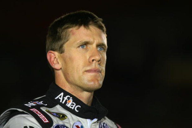 CONCORD, NC - OCTOBER 15:  Carl Edwards, driver of the #99 Aflac Ford, stands on pit road during qualifying for the NASCAR Sprint Cup Series NASCAR Banking 500 at Lowe's Motor Speedway on October 15, 2009 in Concord, North Carolina.  (Photo by Jason Smith