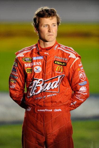 CONCORD, NC - OCTOBER 15:  Kasey Kahne, driver of the #9 Budweiser Dodge, stands on pit road during qualifying for the NASCAR Sprint Cup Series NASCAR Banking 500 at Lowe's Motor Speedway on October 15, 2009 in Concord, North Carolina.  (Photo by John Har