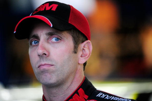 CONCORD, NC - OCTOBER 15:  Greg Biffle, driver of the #16 3M Ford, stands in the garage during practice for the NASCAR Sprint Cup Series NASCAR Banking 500 at Lowe's Motor Speedway on October 15, 2009 in Concord, North Carolina.  (Photo by Sam Greenwood/G