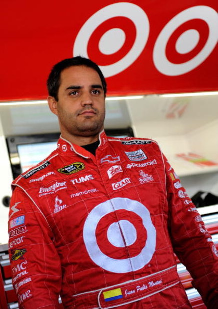 KANSAS CITY, KS - OCTOBER 02: Juan Pablo Montoya, driver of the #42 Target Chevrolet stands in the garage while adjustments are made to his car during practice for the NASCAR Sprint Cup Series Price Chopper 400 presented by Kraft Foods at the Kansas Speed