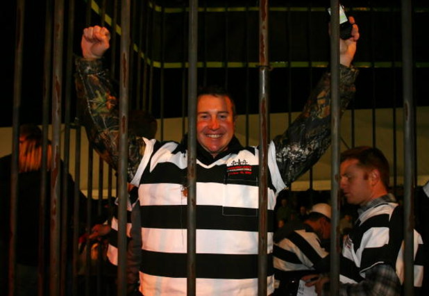 DAVIDSON, NC - OCTOBER 14:  NASCAR driver Kurt Busch (C) is locked up for charity at the NASCAR Second Annual Jail & Bail held at Brickhouse Tavern  October 14, 2009 in Davidson, North Carolina.  Funds raised during the event will go to The NASCAR Foundat