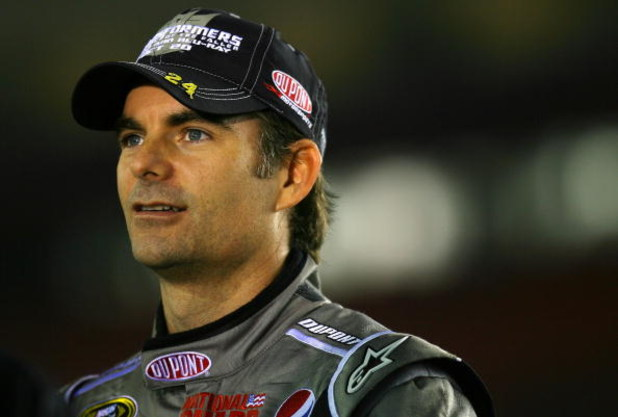 CONCORD, NC - OCTOBER 15:  Jeff Gordon, driver of the #24 Transformers Chevrolet, stands on pit road during qualifying for the NASCAR Sprint Cup Series NASCAR Banking 500 at Lowe's Motor Speedway on October 15, 2009 in Concord, North Carolina.  (Photo by