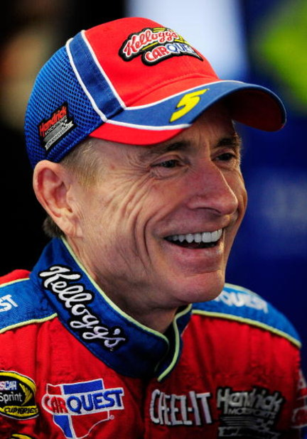 CONCORD, NC - OCTOBER 15:  Mark Martin, driver of the #5 Pop-Tarts Chevrolet, stands in the garage during practice for the NASCAR Sprint Cup Series NASCAR Banking 500 at Lowe's Motor Speedway on October 15, 2009 in Concord, North Carolina.  (Photo by Sam