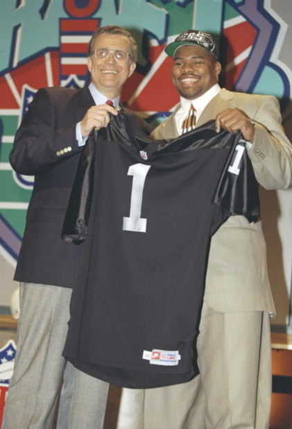19 Apr 1997:  Defensive tackle Darrell Russell of the Southern California Trojans holds jersey of the Oakland Raiders at the NFL Draft at Paramount Studios in Manhattan, New York.  Russell was the number two pick.  Mandatory Credit: Al Bello  /Allsport