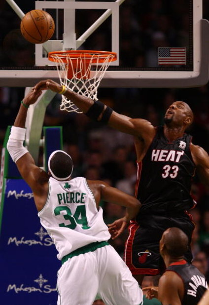 BOSTON - NOVEMBER 16:  Paul Pierce #34 of the Boston Celtics tries to get a shot as Alonzo Mourning #33 of the Miami Heat defends on November 16, 2007 at the TD Banknorth Garden in Boston, Massachusetts. NOTE TO USER: User expressly acknowledges and agree