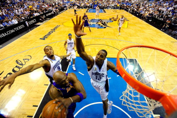 ORLANDO, FL - JUNE 14:  Lamar Odom #7 of the Los Angeles Lakers goes to the basket against Rashard Lewis #9 and Dwight Howard #12 of the Orlando Magic in Game Five of the 2009 NBA Finals on June 14, 2009 at Amway Arena in Orlando, Florida.  NOTE TO USER:
