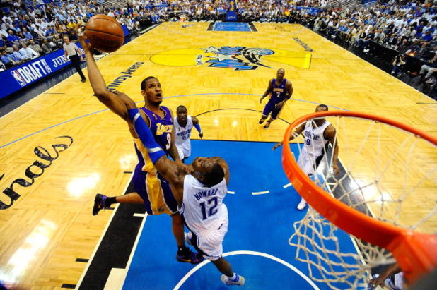 ORLANDO, FL - JUNE 14: Trevor Ariza #3 of the Los Angeles Lakers goes to the basket against Dwight Howard #12 of the Orlando Magic in Game Five of the 2009 NBA Finals on June 14, 2009 at Amway Arena in Orlando, Florida.  NOTE TO USER:  User expressly ackn