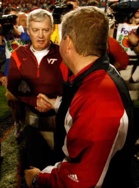 MIAMI - JANUARY 01:  Head coach Brian Kelly (R) of the Cincinnati Bearcats shakes hands with Head coach Frank Beamer of the Virginia Tech Hokies after the FedEx Orange Bowl at Dolphin Stadium on January 1, 2009 in Miami, Florida.  (Photo by Streeter Lecka