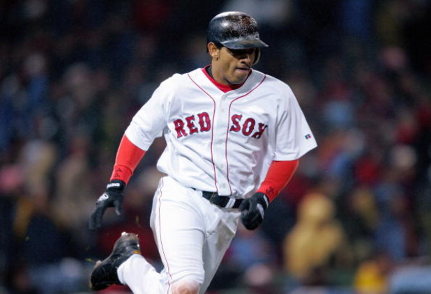 BOSTON - OCTOBER 24:  Orlando Cabrera #44 of the Boston Red Sox runs the bases during game two of the 2004 World Series against the St. Louis Cardinals on October 24, 2004 at Fenway Park in Boston, Massachusetts. (Photo by Elsa/Getty Images)