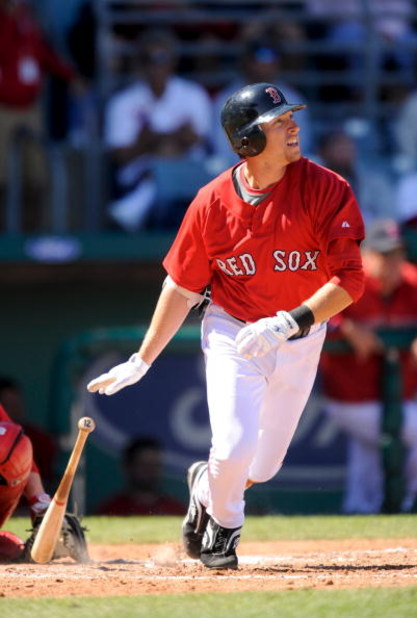 FORT MYERS, FL - MARCH 03: Jed Lowrie #12 of the Boston Red Sox bats against the Cincinnati Reds at the City of Palms Park on March 3, 2009 in Fort Myers, Florida.  (Photo by Rob Tringali/Getty Images)