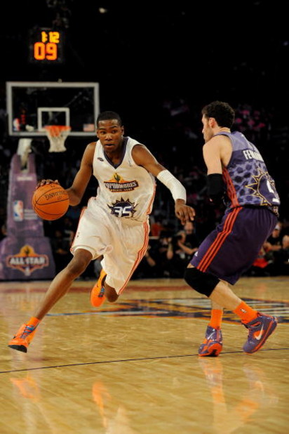 PHOENIX - FEBRUARY 13:  Kevin Durant #35 of the Sophomore team drives to the basket against Rudy Fernandez #5 of the Rookie team during the T-Mobile Rookie Challenge & Youth Jam part of 2009 NBA All-Star Weekend at US Airways Center on February 13, 2009 i