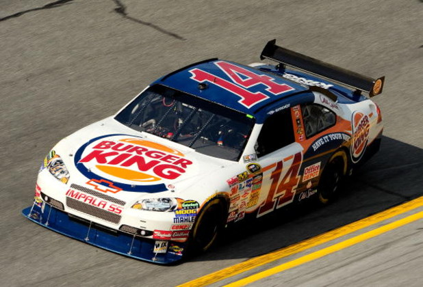 DAYTONA BEACH, FL - JULY 02: Tony Stewart, driver of the #14 Burger King Chevrolet, drives during practice for the NASCAR Sprint Cup Series Coke Zero 400 at Daytona International Speedway on July 2, 2009 in Daytona Beach, Florida.  (Photo by Sam Greenwood
