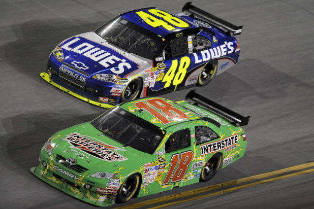 DAYTONA BEACH, FL - JULY 04: Kyle Busch, driver of the #18 Interstate Batteries Toyota, leads Jimmie Johnson, driver of the #48 Lowe's/Kobalt Tools Chevrolet, during the NASCAR Sprint Cup Series 51st Annual Coke Zero 400 at Daytona International Speedway
