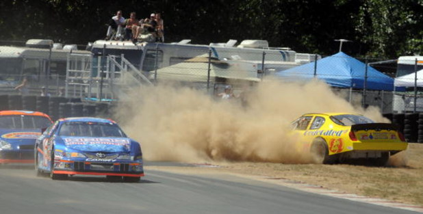 PORTLAND, OR - JULY 19: Jim Inglebright spins out into the grass on turn 7 during the NASCAR Camping World Series West BI-MART Salute to the Troops 125 at Portland International Raceway on July 19, 2009 in Portland, Oregon. Inglebright won the race. (Phot