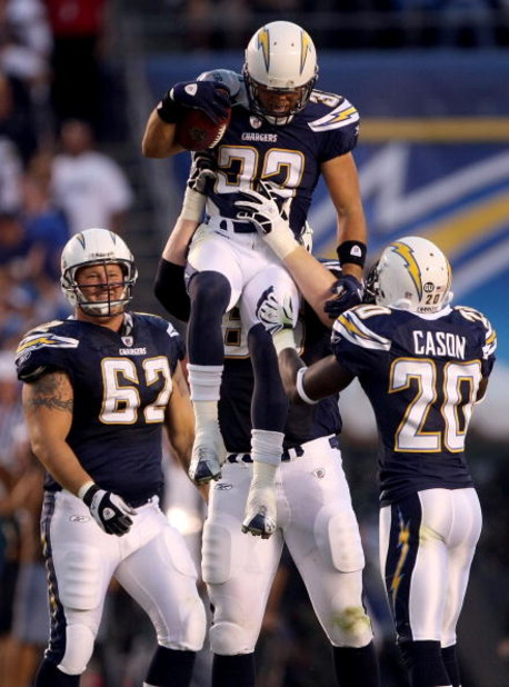 SAN DIEGO - SEPTEMBER 22:  Eric Weddle #32 of the San Diego Chargers celebrates with teammates after an interception by Weddle in the second quarter against the New York Jets on September 22, 2008 at Qualcomm Stadium in San Diego, California.  (Photo by S