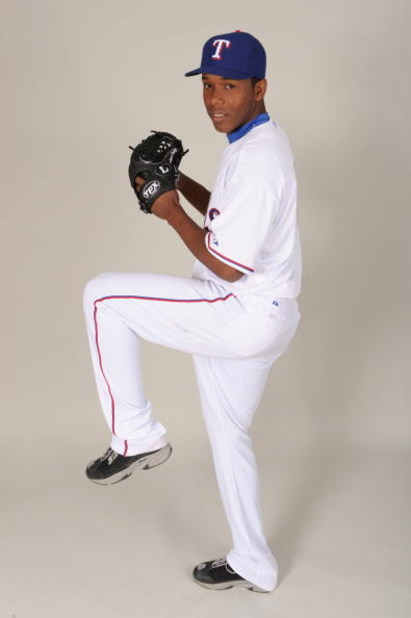 SURPRISE, ARIZONA - FEBRUARY 24:  Neftali Feliz #66 of the Texas Rangers during photo day at Surprise Stadium on February 24, 2009 in Surprise, Arizona. (Photo by: Harry How/Getty Images)