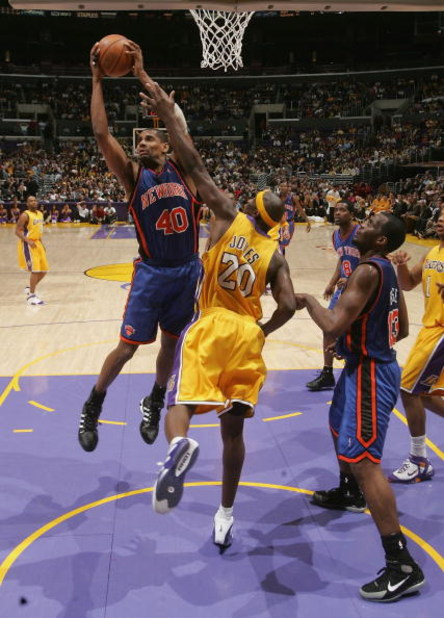 LOS ANGELES - MARCH 29:  Kurt Thomas #40 of the New York Knicks grabs a rebound from Jumaine Jones #20 of the Los Angeles Lakers on March 29, 2005 at Staples Center in Los Angeles, California. The Lakers won 117-107.  NOTE TO USER: User expressly acknowle