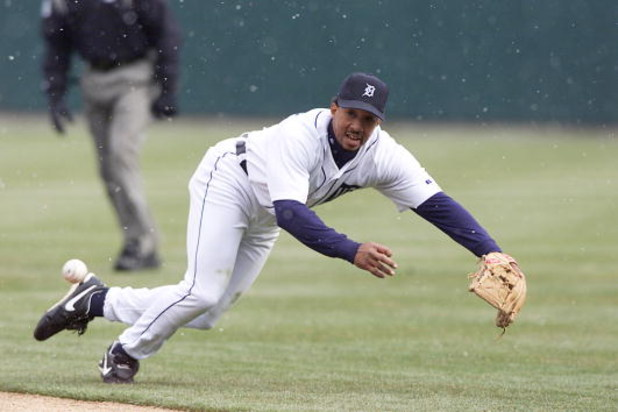 05 APRIL 2002:  Damion Easley #9, of the Detroit Tigers  tries to field a ground ball against the Cleveland Indians at the Tigers'' home opener at Comerica Park in Detroit,  MI. Cleveland won the game 10-1. DIGITAL IMAGE. Mandatory Credit: Tom Pidgeon/Get