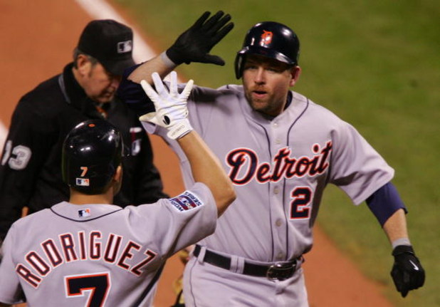 ST LOUIS - OCTOBER 26:  Sean Casey #21 of the Detroit Tigers celebrates with Ivan Rodriguez after Casey hit a solo home run in the top of the second inning against Jeff Suppan #37 of the St. Louis Cardinals during Game Four of the 2006 World Series on Oct