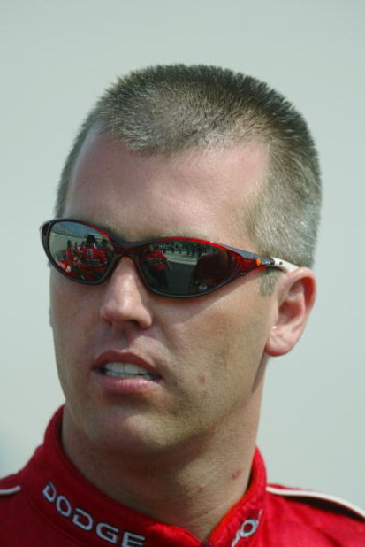 DOVER, DE - SEPTEMBER 20:  Jeremy Mayfield driver of the #19 Evernham Motorsports Dodge Intrepid R\T looks on during qualifying for the NASCAR Winston Cup Series MBNA All-American Heroes 400 on September 20, 2002 at Dover Downs in Dover, Delaware. (Photo