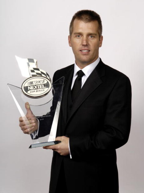 NEW YORK - DECEMBER 2:  Ninth placed Jeremy Mayfield, driver of the #19 Evernham Motorsports Dodge, poses during the NASCAR Nextel Cup Awards Banquet on December 2, 2005 at the Waldorf Astoria Hotel in New York City.  (Photo By Rusty Jarrett/Getty Images)