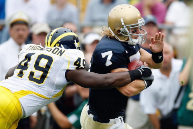 SOUTH BEND,IN - SEPTEMBER 13:  Quarterback Jimmy Clausen #7 of the Notre Dame Fighting Irish runs the ball against John Thompson #49 of the Michigan Wolverines on September 13, 2008 at Notre Dame Stadium in South Bend, Indiana. (Photo by: Gregory Shamus/G
