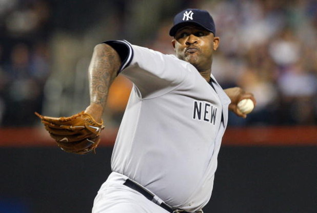 NEW YORK - JUNE 26:  CC Sabathia #52 of the New York Yankees pitches against the New York Mets on June 26, 2009 at Citi Field in the Flushing neighborhood of the Queens borough of New York City.  (Photo by Jim McIsaac/Getty Images)