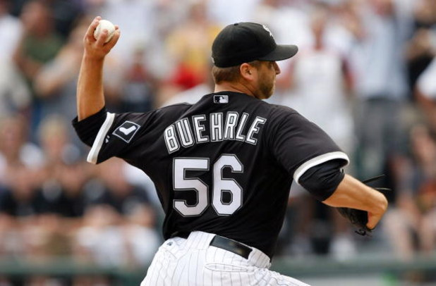 CHICAGO, IL - JULY 23: Pitcher Mark Buehrle #56 of the Chicago White Sox pitches in the 9th inning as he pitches a perfect game against the Tampa Bay Rays at U.S. Cellular Field on July 23, 2009 in Chicago, Illinois. The White Sox defeated the Rays 5-0, a