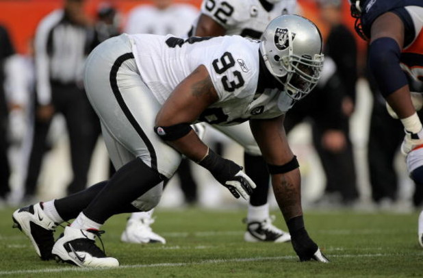 DENVER - NOVEMBER 23:  Defensive tackle Tommy Kelly #93 of the Oakland Raiders defends against the Denver Broncos during week 12 NFL action at Invesco Field at Mile High on November 23, 2008 in Denver, Colorado. The Raiders defeated the Broncos 31-10.  (P