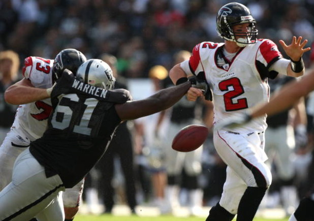 OAKLAND, CA - NOVEMBER 02: Matt Ryan #2 of the Atlanta Falcons fumbles the ball as Gerard Warren #61 of the Oakland Raiders defends during an NFL game on November 2, 2008 at the Oakland-Alameda County Coliseum in Oakland, California.  (Photo by Jed Jacobs