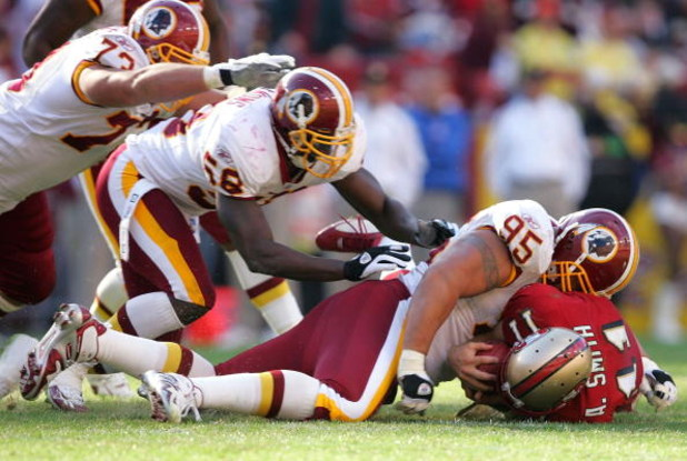 LANDOVER, MD - OCTOBER 23:  Quarterback Alex Smith #11 of the San Francisco 49ers is sacked by Joe Salave'a #95, Chris Clemons #58, and Ryan Boschetti #73 of the Washington Redskins during the second half of the game on October 23, 2005 at Fed Ex Field in