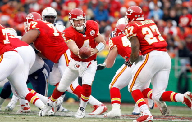KANSAS CITY, MO - DECEMBER 14:  Tyler Thigpen #4 of the Kansas City Chiefs handsoff to Larry Johnson #27 against the San Diego Chargers during the first half on December 14, 2008 at Arrowhead Stadium in Kansas City, Missouri. The Chiefs lost 22-21.  (Phot