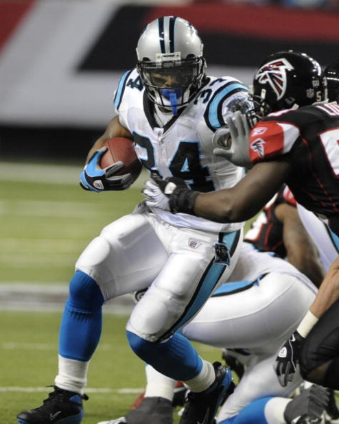 ATLANTA - NOVEMBER 23: Running back DeAngelo Williams #34 of the Carolina Panthers rushes upfield against the Atlanta Falcons at the Georgia Dome on November 23, 2008 in Atlanta, Georgia.  (Photo by Al Messerschmidt/Getty Images)