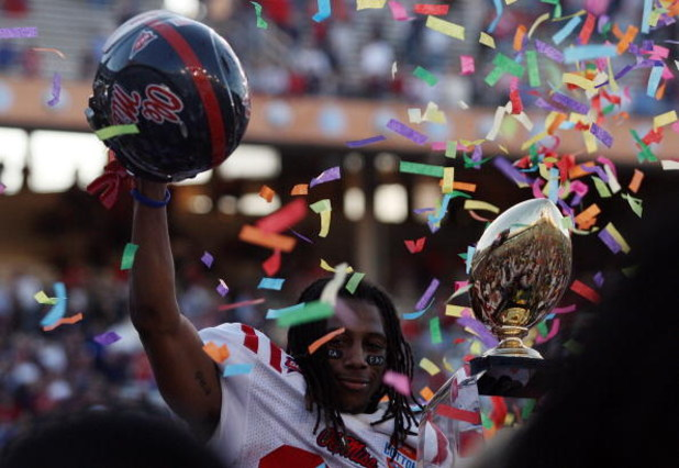 DALLAS - JANUARY 02:  Dexter McCluster #22 of the Mississippi Rebels celebrates a 47-34 win against the Texas Tech Red Raiders during the AT&T Cotton Bowl on January 2, 2009 at the Cotton Bowl in Dallas, Texas.  (Photo by Ronald Martinez/Getty Images)