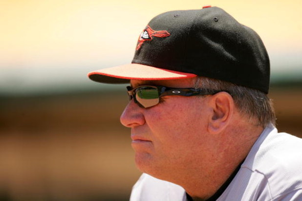 OAKLAND, CA - JUNE 07:  Baltimore Orioles manager Dave Trembley stands in the dugout before their game against the Oakland Athletics at the Oakland Coliseum on June 7, 2009 in Oakland, California.  (Photo by Ezra Shaw/Getty Images)