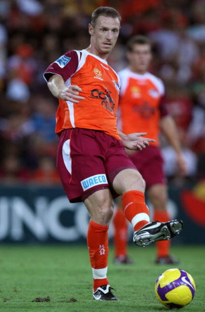 BRISBANE, AUSTRALIA - FEBRUARY 13:  Craig Moore of the Roar passes the ball during the minor semi final 2nd leg match between the Queensland Roar and the Central Coast Mariners held at Suncorp Stadium on February 13, 2009 in Brisbane, Australia.  (Photo b